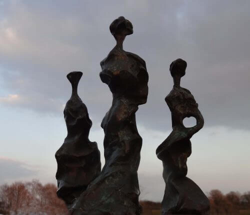 Three Sisters at dusk - semi-abstract bronze sculpture of three standing figures