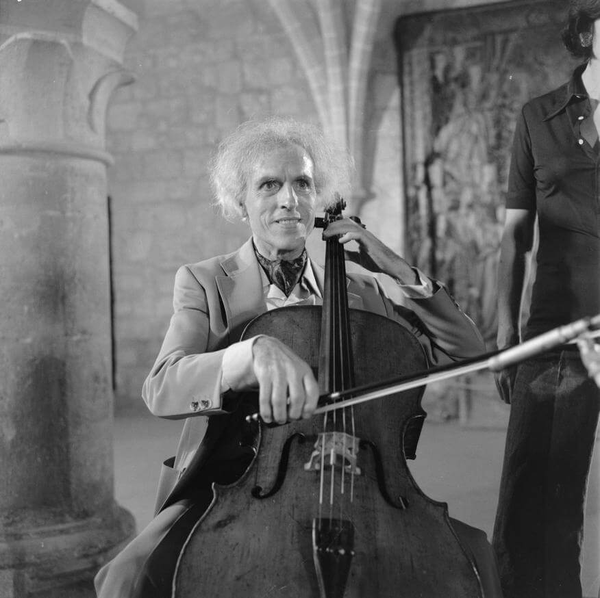 Tortelier - cellist playing in stone, gothic building