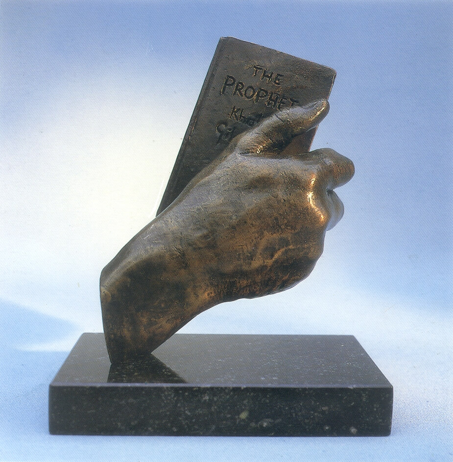 Abstract bronze sculpture of couple kissing.