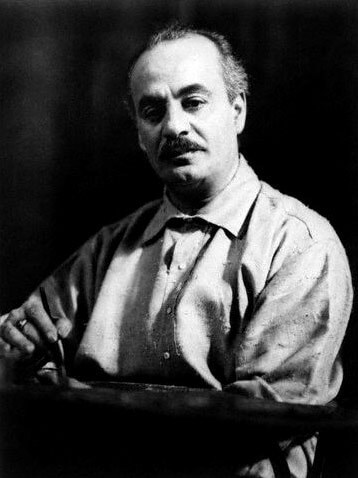 A black-and-white portrait photo of Kahlil Gibran as an older man