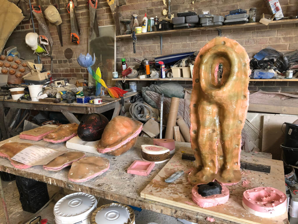 A collection of casting moulds on a workbench in the workshop.